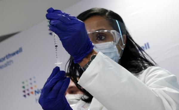 A medical worker at South Shore University Hospital gets ready to administer the newly available Johnson & Johnson COVID-19 vaccine in Bay Shore, N.Y., Wednesday. Clinical research found it to be 85% effective in preventing severe disease four weeks after