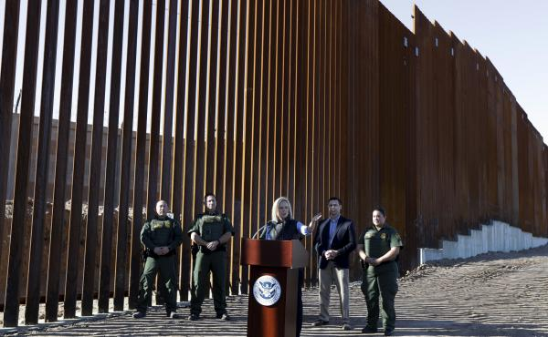 U.S. Department of Homeland Security Secretary Kirstjen Nielsen speaks in front of a newly fortified border wall structure in Calexico, Calif. in October. A federal court ruled Monday that DHS has broad authority to waive environmental regulations in the