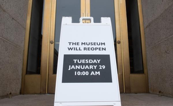 A sign at the entrance of the Smithsonian National Museum of Natural History in Washington, D.C., says the museum will reopen Tuesday. The shutdown reduced federal spending by $18 billion, although most of that will be recouped now that the government has
