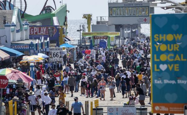 The Santa Monica Pier welcomed outdoor visitors on Monday as Los Angeles County entered the less-restrictive orange tier. The following day, California Gov. Gavin Newsom announced a target statewide reopening date of June 15, provided certain public healt