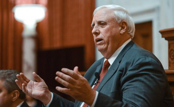 West Virginia Gov. Jim Justice delivers his State of the State speech on Jan. 9 in Charleston, W.Va. Mining companies belonging to the Justice family owe millions in safety violations.