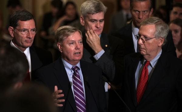 Sen. Lindsey Graham, second from left, speaks as Sen. John Barrasso, from left, Sen. Bill Cassidy, Sen. John Thune and Senate Majority Leader Sen. Mitch McConnell listen during a news briefing after the weekly Senate Republican policy luncheon on Tuesday.