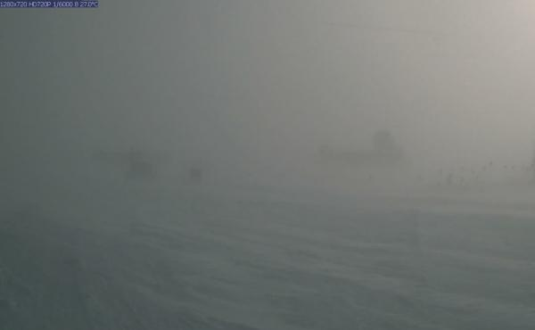 A webcam still showing blizzard conditions at Summit Station, a weather research station at Greenland's highest point. In August, the station recorded rain for the first time ever.