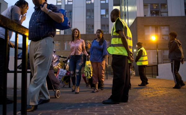 Officials evacuate residents of the Chalcots Estate, in London's Camden borough on Friday evening. Camden's local council decided to evacuate the hundreds of households due to safety concerns following the devastating fire that killed 79 people in Grenfel