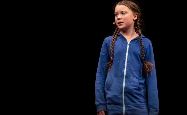Greta Thunberg on the TED stage.