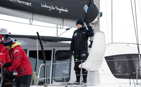 Swedish climate activist Greta Thunberg waves aboard the catamaran La Vagabonde as she sets sail for Europe from Hampton, Va., on Wednesday.