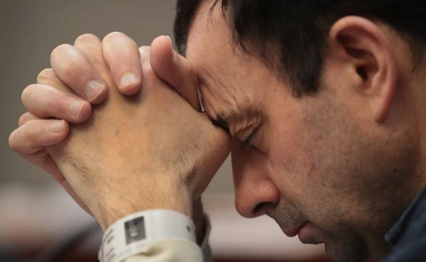 Larry Nassar listens to victim impact statements prior to being sentenced after being accused of molesting more than 140 women and girls while he was a physician for Team USA and Michigan State University. Nassar has pleaded guilty in Ingham County, Mich.