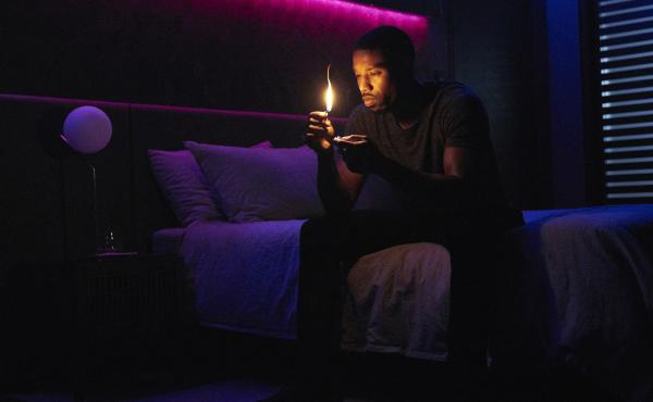 Erasing Himself From The Narrative: Fireman Guy Montag (Michael B. Jordan) contemplates conflagration in the HBO movie Fahrenheit 451.