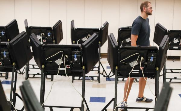 Voters cast their ballots in August among an array of electronic voting machines in a polling station at the Noor Islamic Cultural Center in Dublin, Ohio. The machines were manufactured by Elections Systems and Software, the largest manufacturer of voting