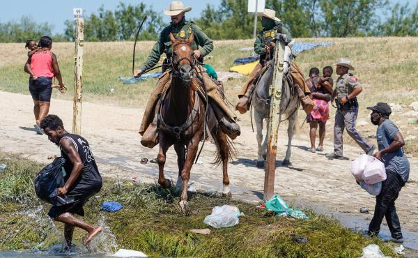 United States Border Patrol agents on horseback try to stop Haitian migrants from entering an encampment on the banks of the Río Grande near the Acuña Del Río International Bridge in Del Río, Texas on Sept. 19.