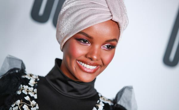Somali American and Muslim model Halima Aden wears a burkini for Sports Illustrated's swimsuit issue, sparking both praise and criticism on social media.