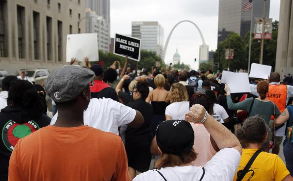 Protesters march to the Thomas F. Eagleton Federal Courthouse on Aug. 10, 2015, in St. Louis.