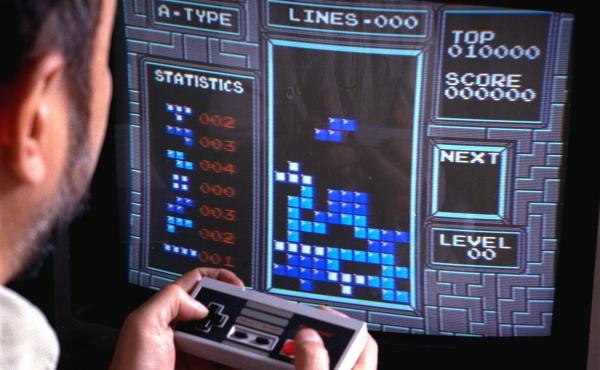 """Tetris, an addictive brain-teasing video game, is shown as played on the Nintendo Entertainment System in New York, June 1990. Its creator, a Soviet computer programmer, explained the game appeals to people's """"constructive spirit."""""""