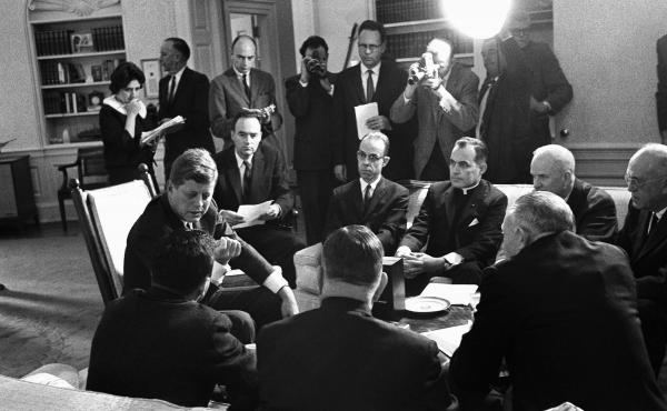 President John F. Kennedy and members of the Civil Rights Commission pose during a White House conference in Washington in 1961. Wofford is seated to Kennedy's left.