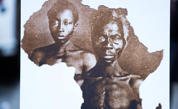 "A sample image of ""Papa"" Renty and his daughter Delia, taken in 1850, are displayed during a press conference announcing a lawsuit against Harvard University on Wednesday in New York City."