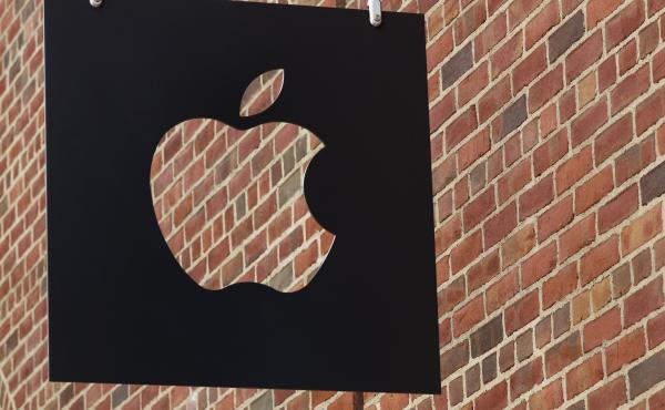The Apple logo hangs in front of an Apple Store in Brooklyn, N.Y.