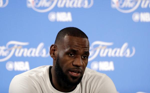 """After racist graffiti was sprayed on the gate of his house in Los Angeles, the Cleveland Cavaliers' LeBron James spoke about racism, saying """"Hate in America, especially for African-Americans, is living every day."""""""
