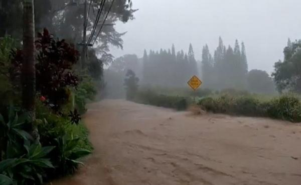 A road is flooded near the breached Kaupakalua Dam in the Haiku area of the Hawaiian island of Maui on Monday.