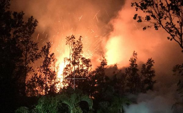 A new lava vent opened up on a residential street in the Leilani Estates neighborhood near Kīlauea volcano Friday morning. Spatter was being thrown nearly 100 feet high at the time the photo was made.