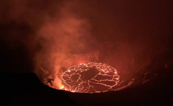 Crews observe the continuing eruption in Halema'uma'u at Kilauea in the early morning of Dec. 28. Overnight, the western vent in the wall of Halema'uma'u continued to erupt.