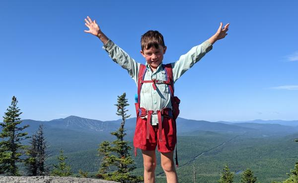 In this July 23 family photo, 5-year-old Harvey Sutton raises his arms while hiking the Appalachian Trail with his parents, Josh and Cassie Sutton.
