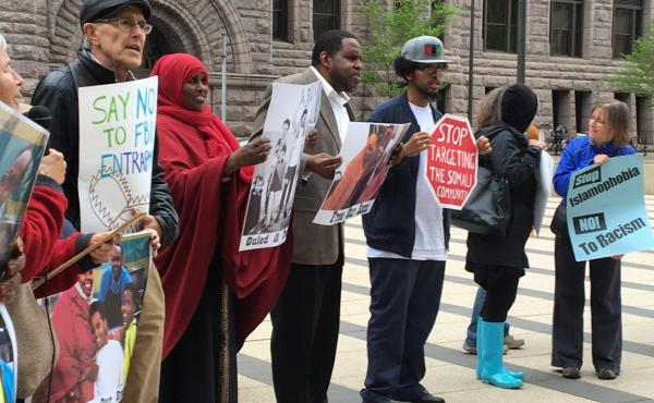 Protesters gathered outside the federal courthouse in Minneapolis where three young Somali-Americans are on trial for allegedly planning to go to Syria to join the Islamic State. The demonstrators say the FBI and local law enforcement is targeting and ent