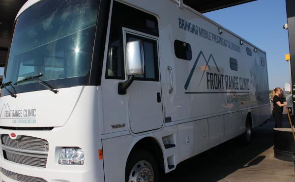 "Each mobile clinic has a nurse, a counselor and a peer specialist — all trained to drive a 34-foot-long motor home. ""I never thought when I went to nursing school that I'd be doing this,"" says Christi Couron as she pumps 52 gallons of diesel fuel into t"