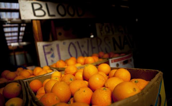 Oranges sit in crates at the Rancho Del Sol Organics farm in San Diego County, Calif., in 2014. A labor dispute at major West Coast ports has left millions of pounds of California oranges stranded in warehouses and on half-loaded boats.