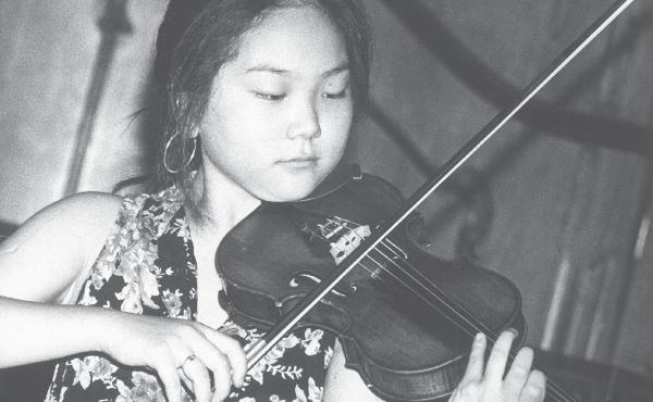 Min Kym is shown at her debut recital at the Serenates D'Estiu Festival in Majorca in July 1992.
