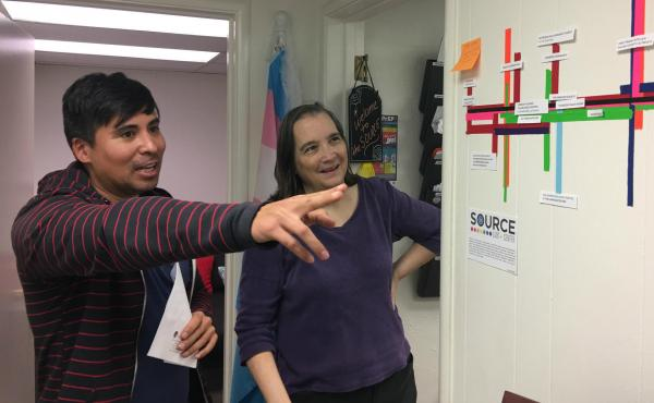 Nick Vargas talks with Dr. Kathryn Hall at The Source, an LGBT center in Visalia, Calif. Hall says that time and time again, her patients tell her they're afraid to come out to their other doctors.