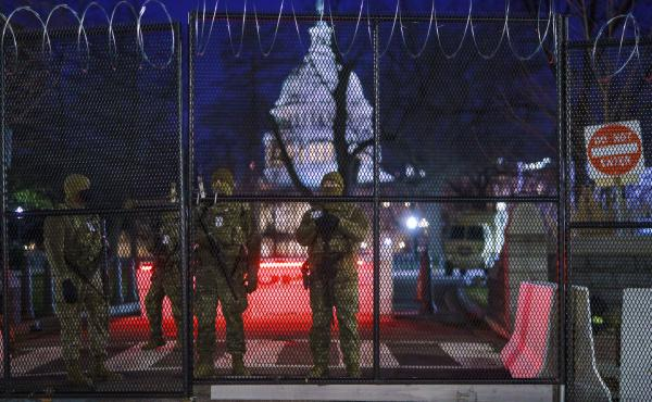 National Guard troops reinforce the security zone on Capitol Hill in Washington early Tuesday, before President-elect Joe Biden is sworn in as the 46th president on Wednesday.
