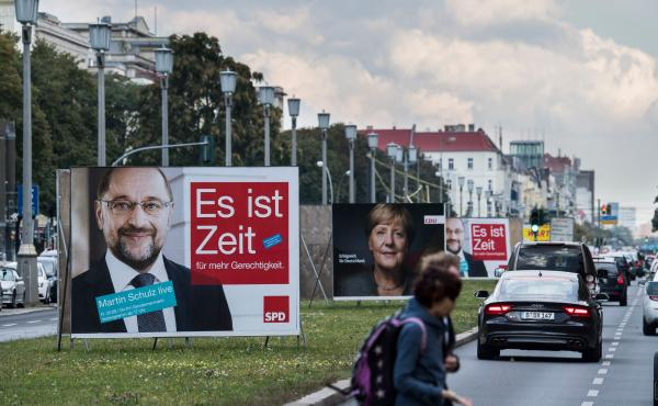 Billboards featuring German Chancellor Angela Merkel (center) and Martin Schulz (left), leader of Germany's Social Democratic Party and candidate for chancellor, are pictured in Berlin on Sept. 17.