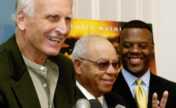 Former high school football coach Herman Boone, center, has died at age 84. He's seen here with his friend and colleague Bill Yoast, left — who died earlier this year — and former Rep. J.C. Watts, Jr.