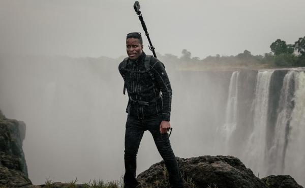 Tawanda Kanhema in 2018 wearing Google Street View camera gear at Victoria Falls in Zimbabwe.