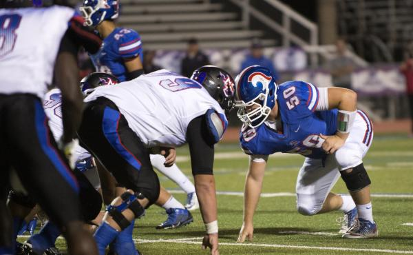 High school athlete Graham Hill, number 50, suffered a concussion in 2013 while playing football at Trinity Christian Academy in Addison, Texas.