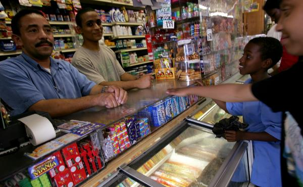 """Jesus Martinez (L) works at his bodega grocery store in the Queens borough of New York City in 2007. Tech entrepreneurs got pushback for calling their startup """"Bodega."""""""
