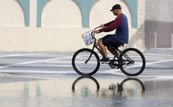 A street in Miami flooded during a high tide in 2018. A new report confirms that the number of days with high-tide flooding is increasing in many U.S. cities as sea levels rise.