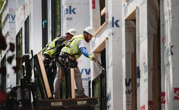 Unusually warm weather contributed to a surge in construction last month, with 44,000 jobs added.