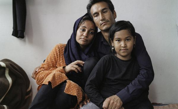Sayyid Ali Hussaini (center), his wife Mahbube and daughter Elisa sit together in the Turkish city of Trabzon. Originally from the northern Afghan city of Mazar-e-Sharif, the family fled Taliban advances over the summer and arrived in Turkey last month.