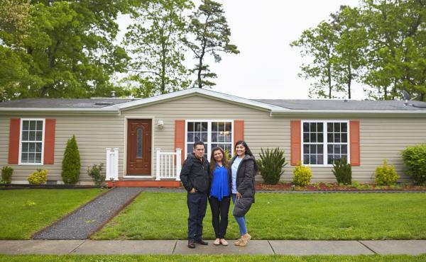 "The Martinez family stands in front of their home in New Jersey. During a speech at her graduation, Alondra said to her parents: ""Mamá, papá, lo logramos."" Mom, dad, we made it."