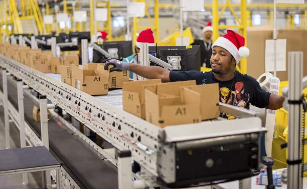 Workers pack items Sunday at an Amazon fulfillment center in Tracy, Calif. Cyber Monday online sales jumped 8.5 percent over 2013.