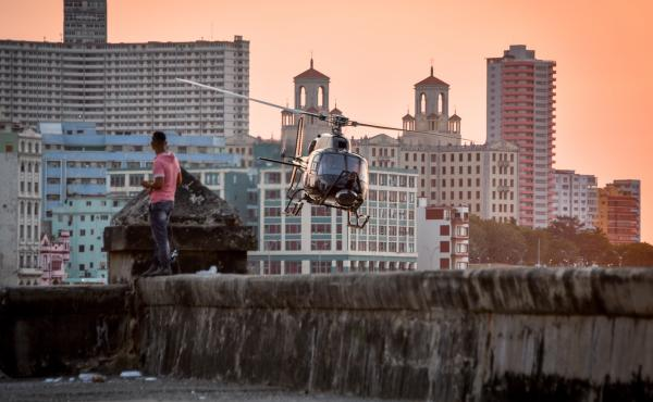 A helicopter used in the shooting of Fast and Furious 8 flies along the waterfront in Havana last week. American filmmakers could not work in Cuba for more than a half century, but a improved relations have opened the doors recently.