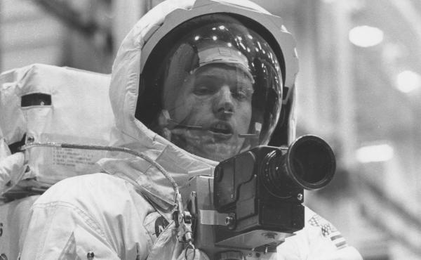 Neil Armstrong tests out his spacesuit and camera in April 1969, three months before he would actually set foot on the moon.