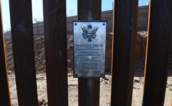 A plaque placed by Nielsen is seen on the border wall.