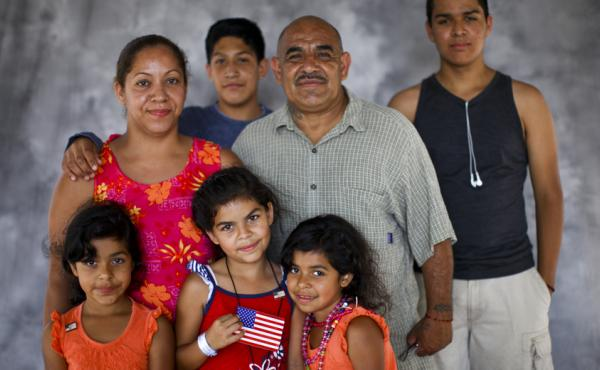 Alexander Morales, who served in the Army in the 1970s, with his family: wife Roberta; Elvia, 7, Elena, 8, and Elvira, 7 (in front), and Ruben Verdugo, 13, and Aaron D. Huerta, 17 (in back). Morales' family has been going for years to the Stand Down event