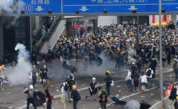 Protesters react after police fired tear gas during a rally against a controversial extradition law proposal outside the government headquarters in Hong Kong on Wednesday.