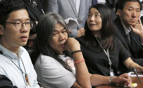 Pro-democracy lawmakers, from left, Nathan Law, Leung Kwok-hung and Lau Siu-lai and Edward Yiu, at a news conference in Hong Kong on Friday following a high court ruling expelling them from the legislature.