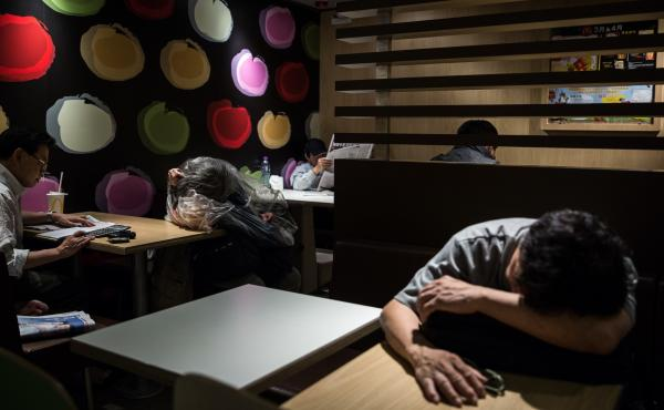 """""""McRefugees"""" sleep at a McDonald's in the Kowloon district of Hong Kong in April 2016."""