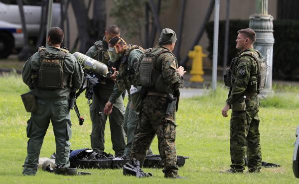Honolulu police gather near the scene of a shooting near Diamond Head State Monument on Sunday.