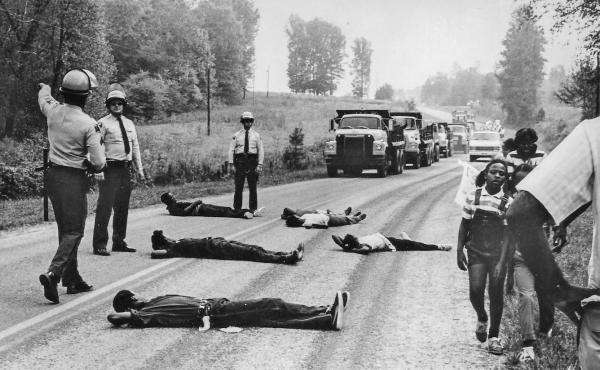 Protestors attempt to block the delivery of toxic PCB waste to a landfill in Warren County, North Carolina, 1982. It was in response to the State's decision to locate a hazardous waste landfill in a low-income, predominantly Black area of Warren County th